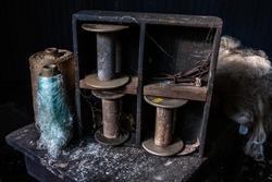 Bobbins and Silk at an abandoned silk mill.