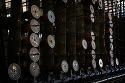 Bobbins stacked up at an abandoned silk mill.