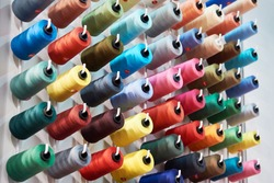 Bobbins with colored thread for industrial textile machines
