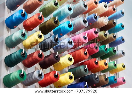Bobbins with colored thread for industrial textile machines #707579920