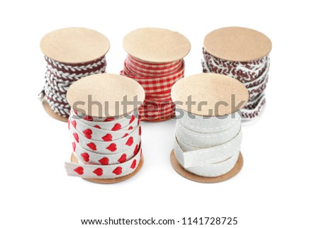 Bobbins with ribbons for scrapbooking on white background - Shutterstock ID 1141728725