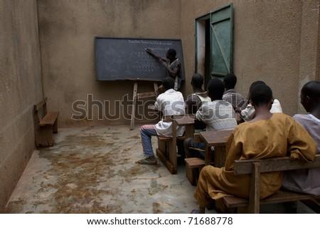 BOBO DIOULASSO,BURKINA FASO - FEB 19: Children in Laye Center, a detention alternative, attend school on February 19, 2005 in Bobo Dioulasso, Burkina Faso.
