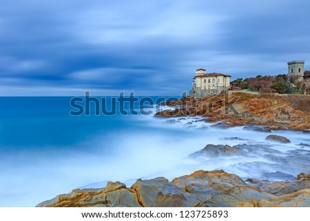 Boccale castle landmark on cliff rock and sea in winter. Tuscany, Italy, Europe