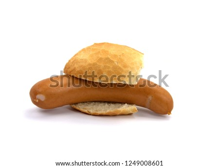 Bock sausage in bread roll isolated against white background