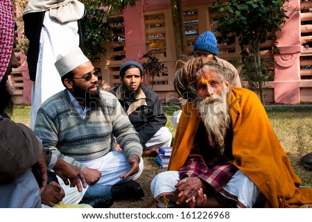 BODHGAYA, INDIA - JAN 8: Muslim group talk with the elderly hindu man about religion on January 8 2013 in Bodhgaya. It is a place of pilgrimage. Siddhartha Gautama attained enlightenment here at 500BC