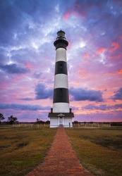 Bodie Island Lighthouse Cape Hatteras National Seashore Outer Banks NC blue and pink sunrise in Nags Head North Carolina