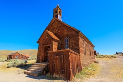 Bodie state historic park of California, United States of America. Methodist Church of 1882 with bell tower of the antique Bodie Californian Ghost Town, close to Yosemite national park.