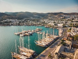 Bodrum Cruise Port southwestern Aegean sea harbor. A stunning view of sailing yachts in Port. Yachts in sunset bay. Sailing boats sunset scene. Sunset yachts view. Yachts in sunset bay.