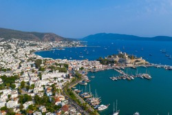 Bodrum is a city on the Bodrum Peninsula, stretching from Turkey's southwest coast into the Aegean Sea. The city features twin bays with views of Bodrum Castle.