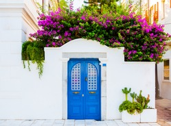 BODRUM, MUGLA, TURKEY. Pink bougainvillea flowers and old blue door in Bodrum. Traditional Bodrum House.