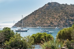 Bodrum's well-known holiday resort Gümüşlük bay and boats in the sea. TURKEY