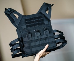 Body armor suit, Bulletproof vest for protection from bullets in the hand.