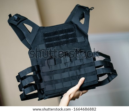 Body armor suit, Bulletproof vest for protection from bullets in the hand. Stock photo ©