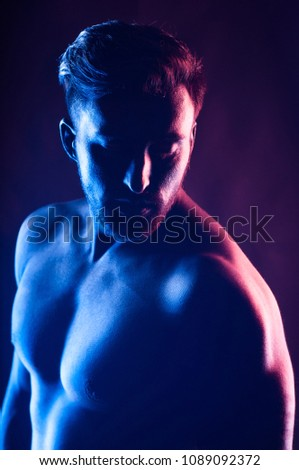 Body art portrait of young athletic handsome man on black background #1089092372