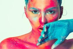 Body art woman face portrait, pink skin with beautiful beauty blue hair, art concept