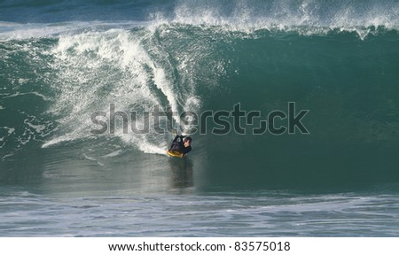 body board on a big wave - stock photo