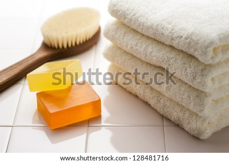 Body brush and soap and towel