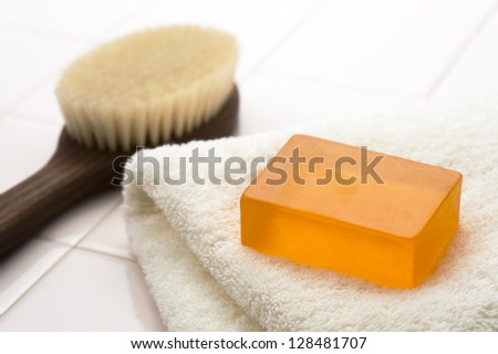 Body brush and soap and towels