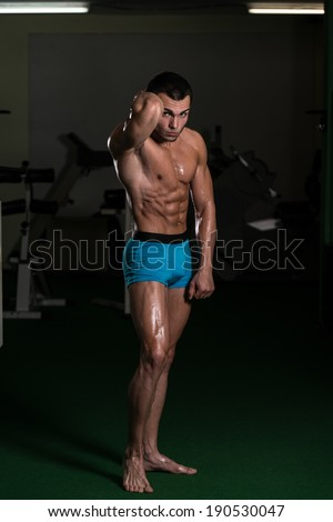 Body Builder Performing Front Abdominal Thigh Poses