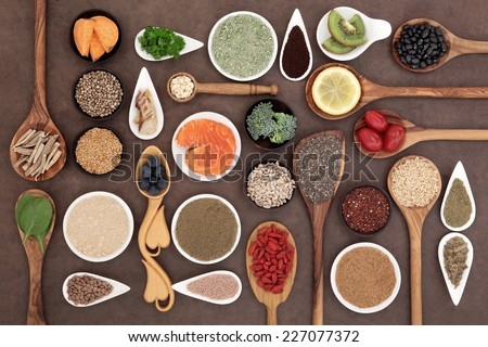 Body building and super health food selection with supplement powders in bowls and spoons over lokta paper background.  Stock photo ©