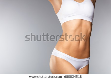 Body Care. Beautiful Woman In Shape With Fit Slim Body, Healthy Smooth Soft Skin In White Bikini Panties On Gray Background. Closeup Female Body In Underwear. Health And Diet Concepts. High Resolution #680834518