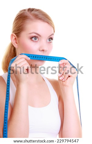 Body care diet and weight loss concept. Fitness girl sporty woman covering her mouth lips with measuring tape isolated on white