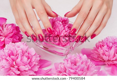 Body care: manicure pampering with pink flowers