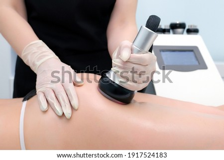 Body cavitation treatment. Ultrasound care to fat reduction. Beauty ultrasonic massage therapy at salon. Anti cellulite massage for buttocks and thighs Photo stock ©