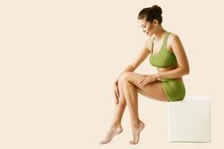 Body Leg Beauty Woman. Natural Skin Care Green Treatment. Slim Model applying depilation Cream. Body Spa Massage