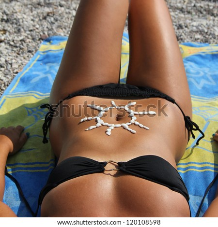 body of a young woman, sunbathing