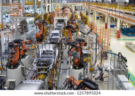 body of car on conveyor top view. Modern Assembly of cars at the plant. The automated build process of the car body