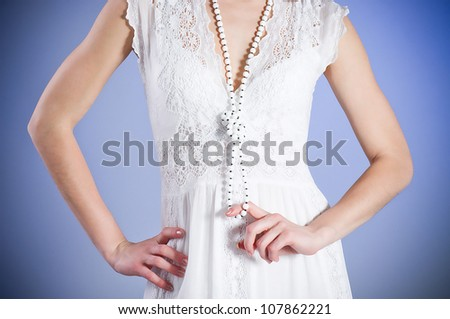 Body of young woman in white bridal dress with beads #107862221