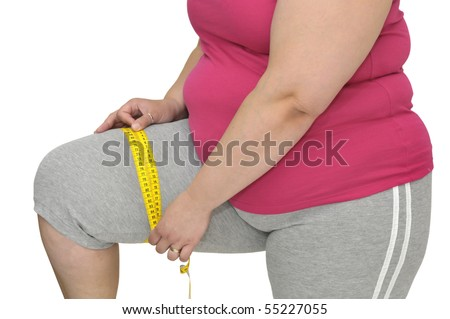 Body part of a fat woman with measuring tape