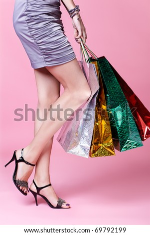 body part portrait of customer long legged girl in court shoes with shopping bags