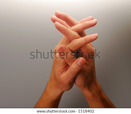 Body parts - Clasped hands, concept for reach, hope, prayer, etc. - stock photo