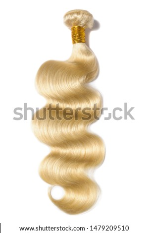 body wave wavy bleached blonde human hair weaves extensions bundles Foto stock ©