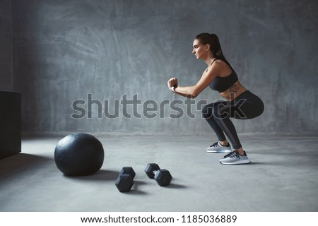 Body Workout. Fitness Woman In Stylish Sports Clothes Exercising #1185036889