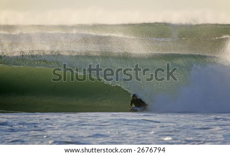 bodyboarder in the tunnel