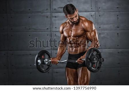 Bodybuilder doing E-Z bar Bicep Curls