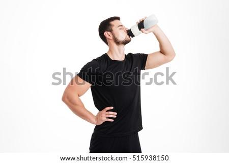 Bodybuilder drinking water. isolated white background