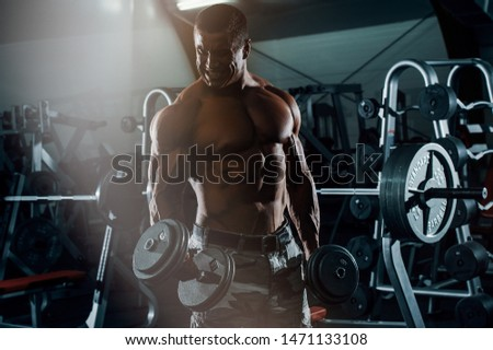 Bodybuilder Exercise With Weights at the Gym, Performing Bicep Curls