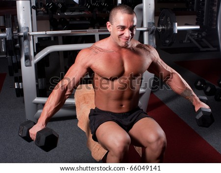 Bodybuilder exercising in a gym