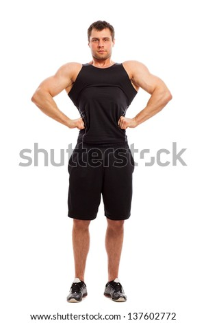 Bodybuilder in fitwear posing isolated  over white background