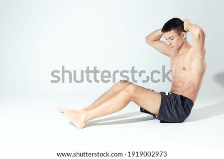 bodybuilder in shorts doing fitness in a bright room inflated torso Stock photo ©