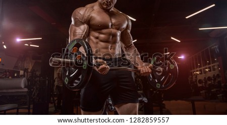Bodybuilder in the gym doing the exercise #1282859557