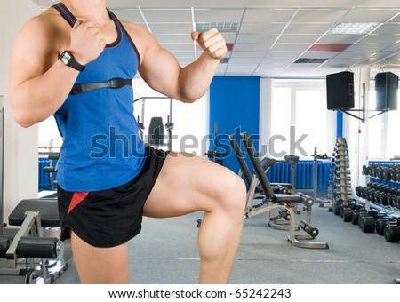 bodybuilder man closeup at gym