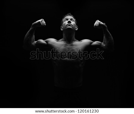 Bodybuilder on black - stock photo