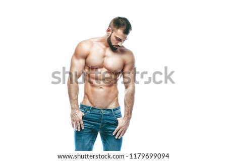 bodybuilder posing. Beautiful sporty guy male power. Fitness muscled in blue jeans. on isolated white background.