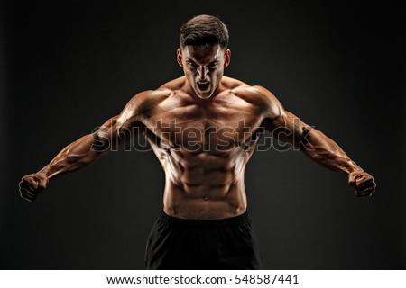 bodybuilder posing. Beautiful sporty guy male power. Fitness muscled man #548587441