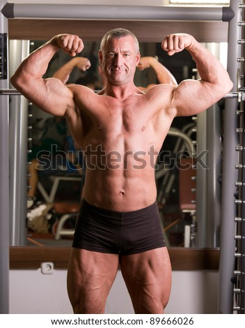 bodybuilder posing in a gym